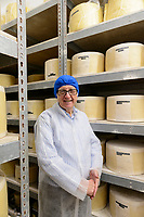 John Spencer, owner of the Cheddar Gorge Cheese Co,. Cheddar Gorge, Cheddar, UK, October 16, 2017. Spectacular Cheddar Gorge features the highest inland cliffs in the UK. The nearby village of Cheddar is also the birthplace of the eponymous cheese.
