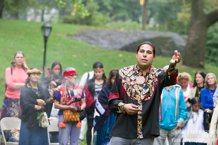 Dallas Goldtooth gestures during a sunrise ceremony organized by Indigenous Leaders prior to the Peoples Climate March in New York. More than 300,000 march in solidarity for Climate accountability, at the People's Climate March on September 21, 2014. (Credit: Robert van Waarden)