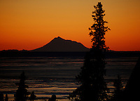 November 30, 2010, Winter sunset view across Cook Inlet of Mount Redoubt Volcano from Goldenview Park, Anchorage, Alaska, United States.