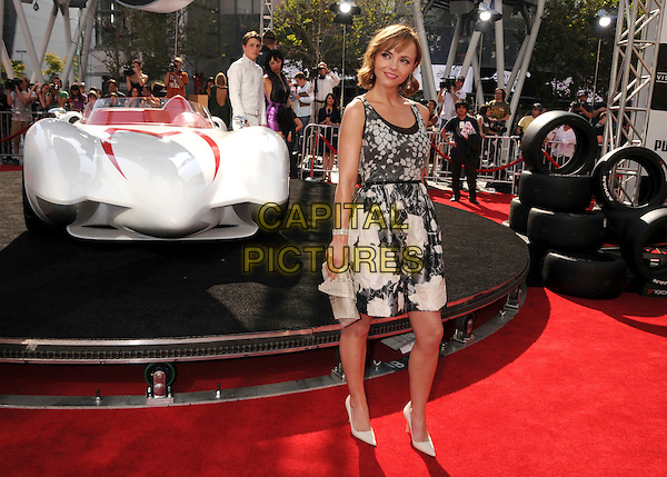 "CHRISTINA RICCI .""Speed Racer"" Los Angeles Premiere at the Nokia Theatre, Los Angeles, California, USA, 26 April 2008..full length grey gray and white top print vest skirt floral beige clutch bag shoes .CAP/ADM/BP.©Byron Purvis/Admedia/Capital PIctures"