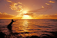 Throw net fisherman at sunset Kihei, Maui.