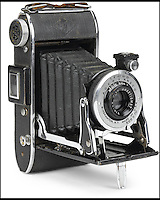 BNPS.co.uk (01202 558833)<br /> Pic: Bonhams/BNPS<br /> <br /> ***Please use full byline***<br /> <br /> 2nd Lt Russell Gackenbach's Agfa camera.<br /> <br /> A never-seen-before photograph of the infamous first atomic bomb dropped on Hiroshima in the final days of World War II has emerged for sale for &pound;30,000.<br /> <br /> The black and white snap was taken from the navigators window of the US airforce Superfortress carrying scientists and journalists to witness the arrival of the atomic age.<br /> <br /> It shows the enormous mushroom cloud rising above the city moments after bomber plane Enola Gay dropped its catastrophic payload on August 6, 1945.<br /> <br /> The poignant photo was taken by Second Lieutenant Russell Gackenbach, navigator onboard Necessary Evil, one of the three B-29 planes that took part in the attack.<br /> <br /> The grainy image of the explosion has never before been published, remaining in 2nd Lt. Gackenback's  posession until the 1990s when he sold it to a private collector.<br /> <br /> A 3-inch by 2-inch contact print of the photo is now up for sale at Bonhams alongside the Agfa Viking camera 2nd Lt. Gackenback used to take the photograph.
