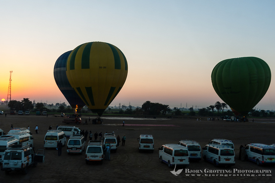 Luxor, Egypt. Balloons landing and taking off close to the Valley of Kings.