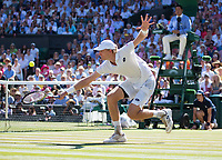 Kevin Anderson (RSA) plays a backhand at the net during the Gentlemen's Singles Final against Novak Djokovic (SRB)