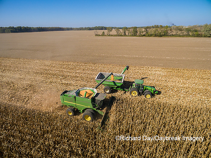 63801-08215 Corn Harvest, John Deere combine unloading corn into grain cart while harvesting - aerial Marion Co. IL