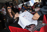 Jul. 27, 2013; Sonoma, CA, USA: NHRA funny car driver Alexis DeJoria holding a fan's T-shirt during qualifying for the Sonoma Nationals at Sonoma Raceway. Mandatory Credit: Mark J. Rebilas-