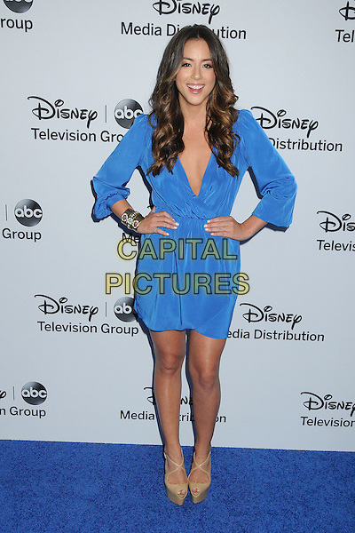 Chloe Bennet.Disney Media Networks International Upfronts 2013 held at Walt Disney Studios, Burbank, California, USA..May 19th, 2013.full length dress blue hands on hips low cut neckline .CAP/ADM/BP.©Byron Purvis/AdMedia/Capital Pictures