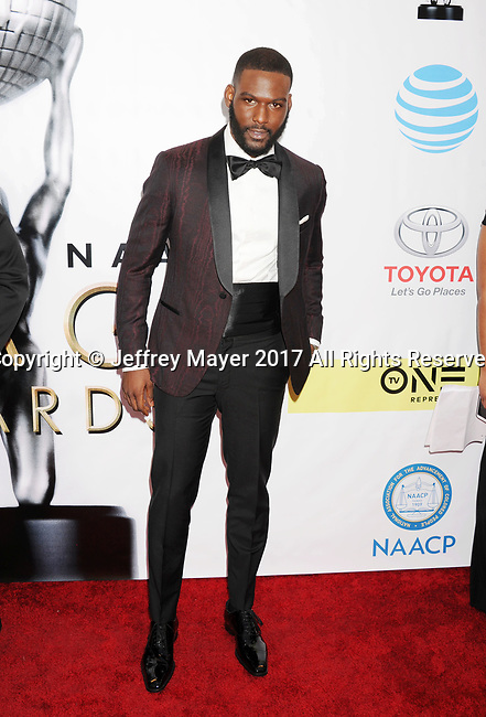 PASADENA, CA - FEBRUARY 11: Actor Kofi Siriboe arrives at the 48th NAACP Image Awards at Pasadena Civic Auditorium on February 11, 2017 in Pasadena, California.