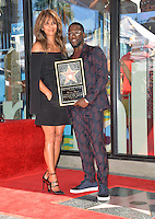LOS ANGELES, CA. October 10, 2016: Kevin Hart &amp; Halle Berry at the Hollywood Walk of Fame Star Ceremony honoring comedian Kevin Hart.<br /> Picture: Paul Smith/Featureflash/SilverHub 0208 004 5359/ 07711 972644 Editors@silverhubmedia.com