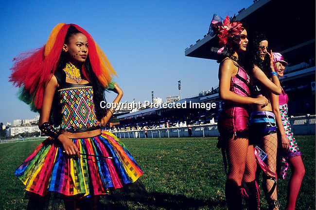 fashion,black,white,race,event,clothes.Fashion models backstage before a show during  the Durban July race on July 3, 2004 at Greyville race course in Durban, South Africa. The event is the biggest social event during the..©Per-Anders Pettersson/iAfrika Photos