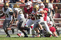 Stanford, CA -- September 13, 2014:  Stanford plays Army at Stanford Stadium.  Dallas Lloyd stops a touchdown rush in the fourth quarter. The Cardinal defeated Army 35-0.