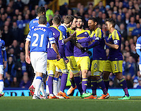 Pictured: Everton and Swansea players square up. Sunday 16 February 2014<br />