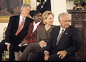 United States President Bill Clinton and first lady Hillary Rodham Clinton host an event in the East Room of the White House advocating expanded use of the internet to place adoptions in Washington, D.C. on November 24, 1998.  From left to right: President Clinton; Charday Mays;  the first lady; and Dave Thomas, founder of Wendy's.<br /> Credit: Ron Sachs / CNP