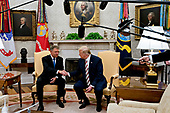 """United States President Donald J. Trump, right, shakes hands with Klaus Iohannis, Romania's president, during a meeting in the Oval Office of the White House in Washington, D.C., U.S., on Tuesday, Aug. 20, 2019. Trump said today he's """"not ready to make a deal with China,"""" but adds Beijing wants an agreement and something could happen soon. <br /> Credit: Andrew Harrer / Pool via CNP"""