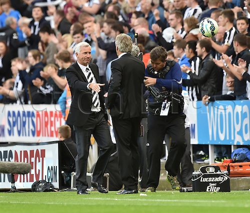 17.08.2014.  Newcastle upon Tyne, England. Premier League. Newcastle United versus Manchester City.  At the end of the game Manchester City Manager Manuel Pellegrini and Newcastle manager Alan Pardew shake hands at the end of the game