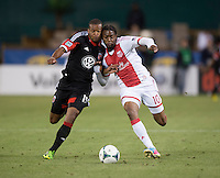 Ethan White (15) of D.C. United goes shoulder to shoulder with Frederic Piquionne (10) of the Portland Timbers during a Major League Soccer match at RFK Stadium in Washington, DC.  The Portland Timbers defeated D.C. United, 2-0.