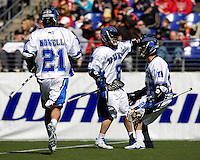 Max Quinzani (8) celebrates a goal with Duke teammates Ned Crotty (22) and Zach Howell (21) during the Face-Off Classic in at M&T Stadium in Baltimore, MD