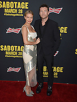 Sam Worthington &amp; girlfriend Lara Bingle at the premiere of his movie &quot;Sabotage&quot; at Regal Cinemas L.A. Live.<br /> March 19, 2014  Los Angeles, CA<br /> Picture: Paul Smith / Featureflash