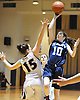 Lily Rakitzis #10 of St. Mary's, right, tries to get a shot past Sara Bradley #15 of Sacred Heart (Buffalo) during the CHSAA varsity girls basketball Class A state final at St. John Villa Academy in Staten Island, NY on Saturday, Mar. 12, 2016. Sacred Heart won by a score of 61-53.