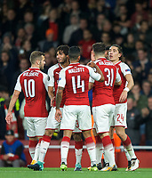 teammates celebrate with goalscorer Hector Bellerin of Arsenal after he makes it 3 1 during the UEFA Europa League match between Arsenal and FC Koln at the Emirates Stadium, London, England on 14 September 2017. Photo by Andrew Aleks.