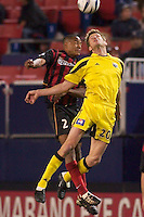 Ricardo Clark of the MetroStars and Brian McBride of the Crew go up for a header. The Columbus Crew defeated the NY/NJ MetroStars 1-0 on 4/12/03 at Giant's Stadium, NJ.