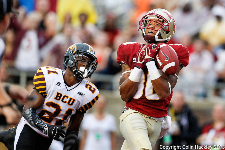 TALLAHASSEE, FLA 9/21/13-FSU-BCC092113CH-Florida State's Rashad Greene can't hang onto a pass in the endzone as Bethune-Cookman's Tim Burke watches during first half action Saturday at Doak Campbell Stadium in Tallahassee. <br /> COLIN HACKLEY PHOTO