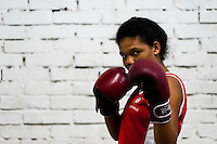 Laura Astudillo, a young Colombian boxer, poses for a picture before a sparring session in the boxing gym in Cali, Colombia, 18 April 2013. During the recent years, Kina Malpartida, a Peruvian female professional boxer, has won the World Championship title several times and so she has become a sporting idol and an inspiration for a generation of young girls throughout Latin America. Working out hard in poorly equipped gyms, they dream of becoming a boxing star. The Cauca Valley and the Caribbean coast are believed to be a home of the most talented female boxers in Colombia.