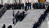 Dignitaries including former Cabinet members and members of the Bush family including former First Lady Laura Bush and President George W. Bush and watch as a military casket team carries casket of former President George. H. W. Bush to the Capitol Rotunda in Washington, DC where he will lie state, December 3, 2018. Credit: Chris Kleponis / CNP