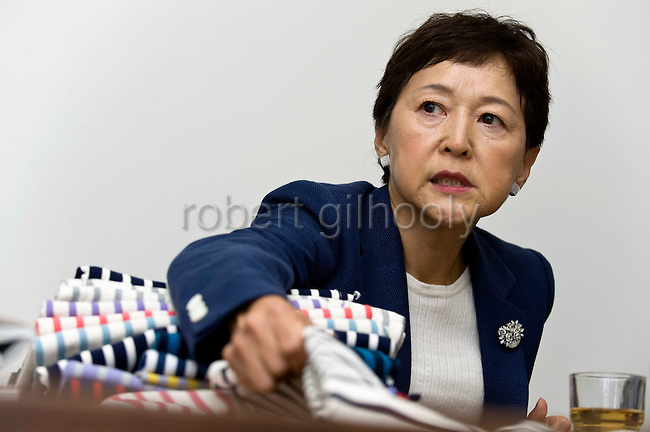 Nori Sakaue, executive director of Innocent Inc., shows some of the textiles sold by the company during an interview at the company's headquarters in Tokyo, Japan on  03 Oct. 2011.