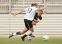 Abby Wambach (blue) of the Washington Freedom  is tackled by Keely Dowling  of Sky Blue F.C. during a WPS pre season match at Maryland Soccerplex, in Boyd's, Maryland on March 14 2009. Sky Blue won the match 1-0