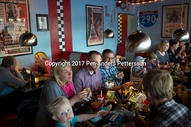 ALVSERED, SWEDEN - MAY 5: A family eats dinner at an American style diner restaurant on May 5, 2017 in Alvsered, Sweden. The dinner is located in a small village and is one of the most popular places to visit for families. (Photo by Per-Anders Pettersson/Getty Images)