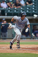 Jordan Gore (10) of the Pensacola Blue Wahoos hustles down the first base line against the Birmingham Barons at Regions Field on July 7, 2019 in Birmingham, Alabama. The Barons defeated the Blue Wahoos 6-5 in 10 innings. (Brian Westerholt/Four Seam Images)