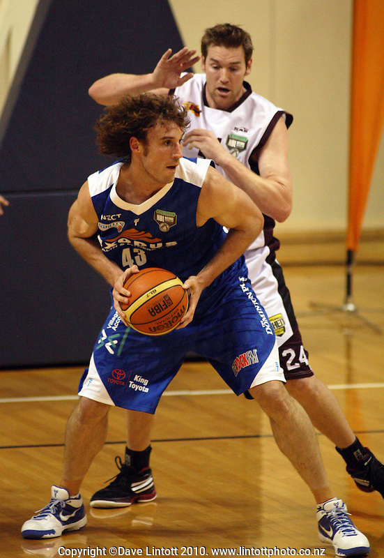Saints forward Casey Frank is pressured by Dillon Boucher during the National Basketball League match between the Wellington Saints and Harbour Heat at TSB Bank Arena, Wellington, New Zealand on Thursday, 29 April 2010. Photo: Dave Lintott / lintottphoto.co.nz