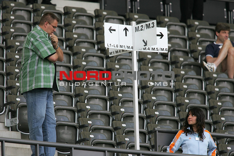 FIFA WM 2006 - Gruppe H ( Group H )<br /> Play #48 (23-Jun) - Ukraine vs Tunisia.<br /> Seats and signs in the Olympic Stadium prior to the match of the World Cup in Berlin.<br /> Foto &copy; nordphoto