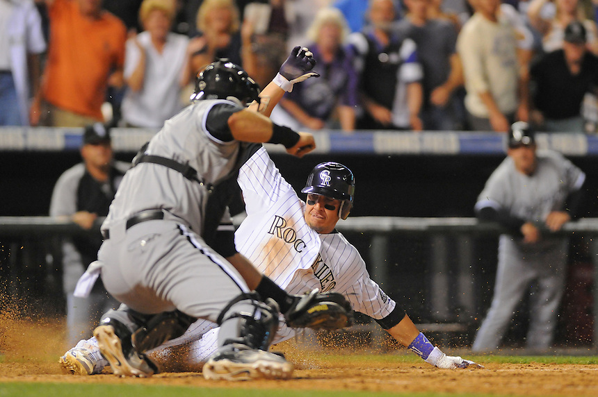 28 JUNE 2011: Colorado Rockies shortstop Troy Tulowitzki (2) slides ahead of a tag attempt by Chicago White Sox catcher A.J. Pierzynski (12) to win the game in the 13th inning during a regular season interleage game between the Chicago White Sox and the Colorado Rockies. The Rockies beat the White Sox 3-2 in 13 innings.   *****For Editorial Use Only*****