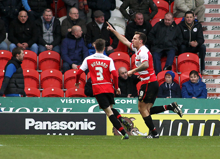 Doncaster Rovers' Chris Brown (right) celebrates scoring the opening goal with team-mate James Husband<br /> <br /> Photo by Rich Linley/CameraSport<br /> <br /> Football - The Football League Sky Bet Championship - Doncaster Rovers v Wigan Athletic - Saturday 18th January 2014 - Keepmoat Stadium - Doncaster<br /> <br /> &copy; CameraSport - 43 Linden Ave. Countesthorpe. Leicester. England. LE8 5PG - Tel: +44 (0) 116 277 4147 - admin@camerasport.com - www.camerasport.com