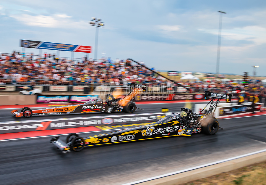 Jul 20, 2018; Morrison, CO, USA; NHRA top fuel driver Leah Pritchett (near) races alongside Clay Millican during qualifying for the Mile High Nationals at Bandimere Speedway. Mandatory Credit: Mark J. Rebilas-USA TODAY Sports
