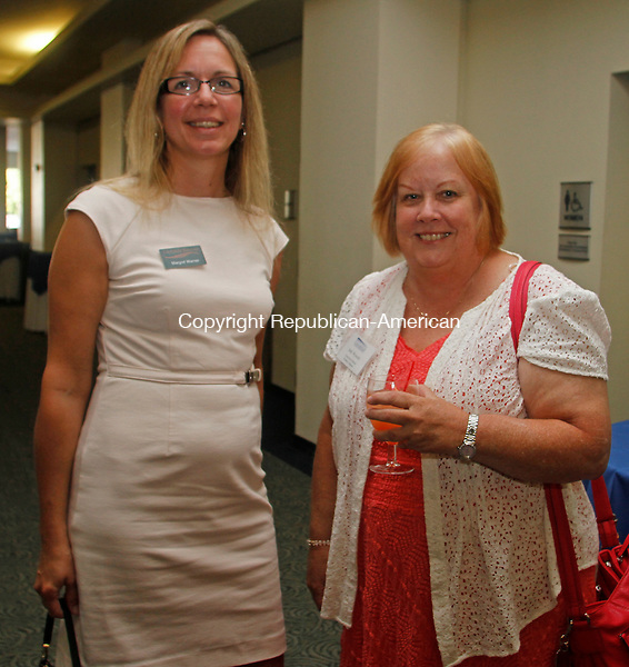 Torrington, CT-24 June 062414MK11 (from left) Margaret Warner, Litchfield Bancorp and Judy Wysocki, CT Mutual Holding CO.  gathered at the Northwest Connecticut's Chamber of Commerce 2014 Celebration of Success in the Carole & Ray Neag Performing Arts Center at The Warner Theatre Tuesday evening.    Michael Kabelka / Republican-American