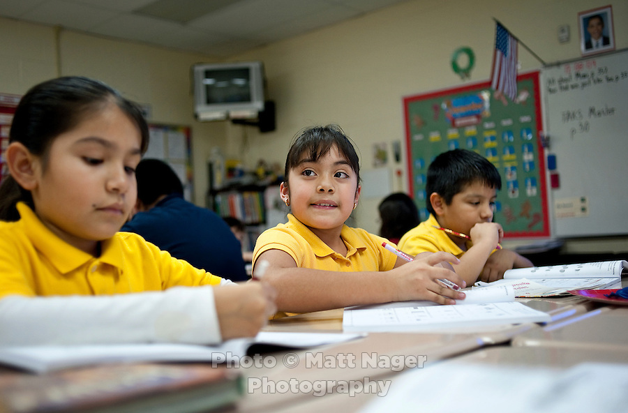 A student works on math during Gilda Martinez's third grade bi-lingual class at C. M. Macdonnell Elementary School in Laredo, Texas, US, Tuesday, Dec., 8, 2009. With over 95 percent of the population as Hispanic Spanish speakers, Laredo ranked the lowest in literacy rates in the 2000 US census. Today there are a number of bi-lingual and dual language classes set up to help students and adults learn english....PHOTOS/ MATT NAGER
