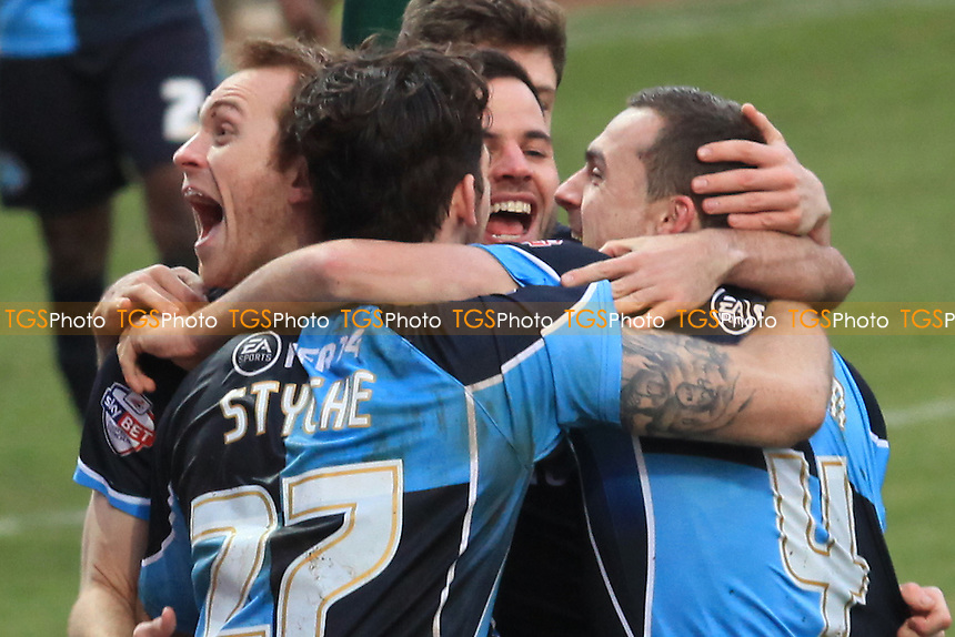 Wycombe players celebrate Josh Scowen's goal at Mansfield - Mansfield Town vs Wycombe Wanderers - Sky Bet League Two Football at the One Call Stadium, Mansfield- 25/01/14 - MANDATORY CREDIT: Paul Dennis/TGSPHOTO - Self billing applies where appropriate - 0845 094 6026 - contact@tgsphoto.co.uk - NO UNPAID USE