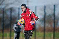 SWANSEA, WALES - JANUARY 28: Lukasz Fabianski of Swansea City walks with the ball during training  on January 28, 2015 in Swansea, Wales.