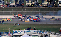 Oct. 31, 2009; Talladega, AL, USA; NASCAR Camping World Truck Series driver Rick Crawford (14) goes airborne as he crashes with Ron Hornaday (33), Mike Skinner (5), and Max Papis (9) during the Mountain Dew 250 at the Talladega Superspeedway. Mandatory Credit: Mark J. Rebilas-