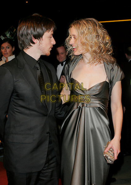 JAMES McAVOY & ANNE-MARIE DUFF.The Orange British Academy Film Awards (BAFTA's) aftershow, The Grosvenor House Hotel, London, UK..February 11th, 2007.half length grey gray dress anne marie black suit jacket couple profile.CAP/AH.©Adam Houghton/Capital Pictures