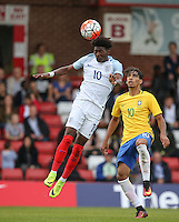 Ainsley Maitland-Niles (Arsenal) of England beats Lucas Paqueta of Brazil to the ball during the International match between England U20 and Brazil U20 at the Aggborough Stadium, Kidderminster, England on 4 September 2016. Photo by Andy Rowland / PRiME Media Images.