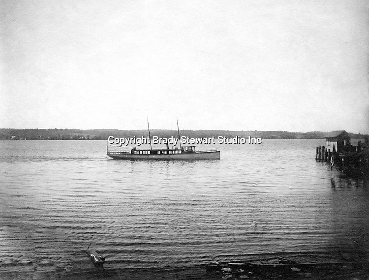 Lakewood NY:  Small Tour boat arriving at the Kent House boat pier - 1901.  Photographs taken during a church field trip to Chautauqua Institution in New York (Lake Chautauqua). The Stewart family and friends visited Chautauqua during 1901 to hear Stewart relative, Dr. S.H. Clark  speak at the institute. Alice Brady Stewart chaperoned and Brady Stewart came along to photograph the trip.  The Gallery provides a glimpse of how the privileged and church faithful spent summers at Lake Chautauqua at the turn of the century.