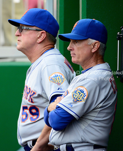 New York Mets manager Terry Collins (10), right, and pitching coach Dan Warthen (59), left, watch their team in the eighth inning against the Washington Nationals at Nationals Park in Washington, D.C. on Sunday, August 19, 2012.   The Nationals won 5 - 2..Credit: Ron Sachs / CNP.(RESTRICTION: NO New York or New Jersey Newspapers or newspapers within a 75 mile radius of New York City)