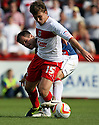 Luke Freeman of Stevenage is tackled by Mike Edwards of Carlisle. Stevenage v Carlisle United - npower League 1 -  Lamex Stadium, Stevenage . - 18th August, 2012. © Kevin Coleman 2012