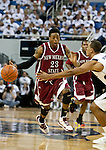 March 1, 2012: New Mexico State Aggies guard Daniel Mullings drives past  Nevada Wolf Pack guard Jordan Burris during their NCAA basketball game played at Lawlor Events Center on Thursday night in Reno, Nevada.