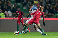 Leiria, Portugal - Tuesday November 14, 2017: Kellyn Acosta, João Mário during an International friendly match between the United States (USA) and Portugal (POR) at Estádio Dr. Magalhães Pessoa.