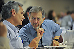 From left, Alaska state representatives Kevin Meyer and  Mike Kelly huddle during the legislature's special session on the proposed gas pipeline Tuesday, June 17, 2008 in Anchorage, Alaska.  ( AP Photo / Michael Dinneen.